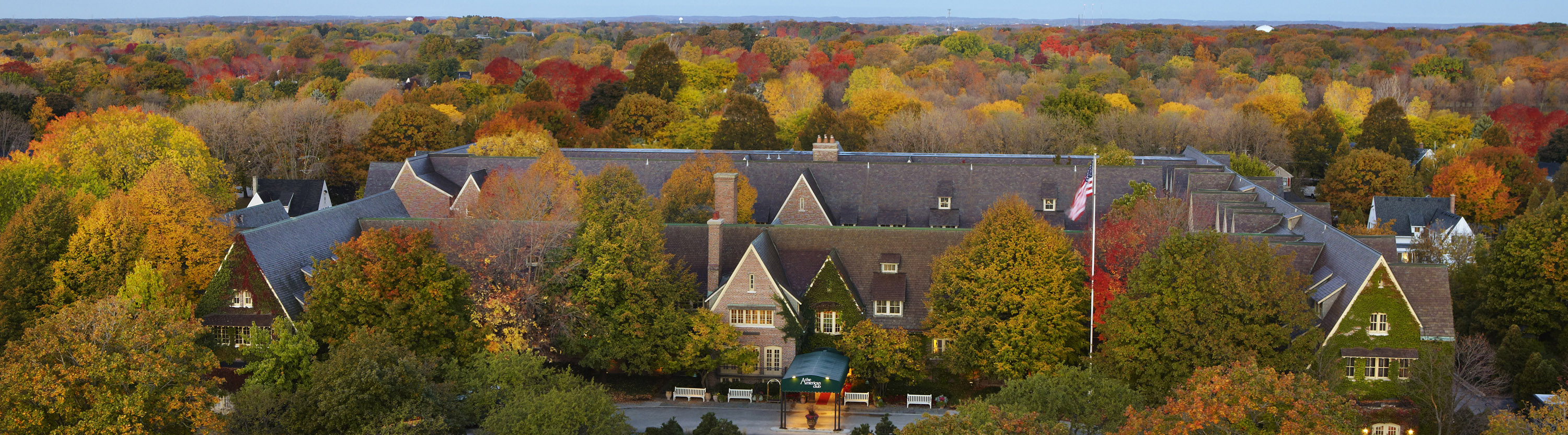 Elegant hotel surrounded by fall foliage
