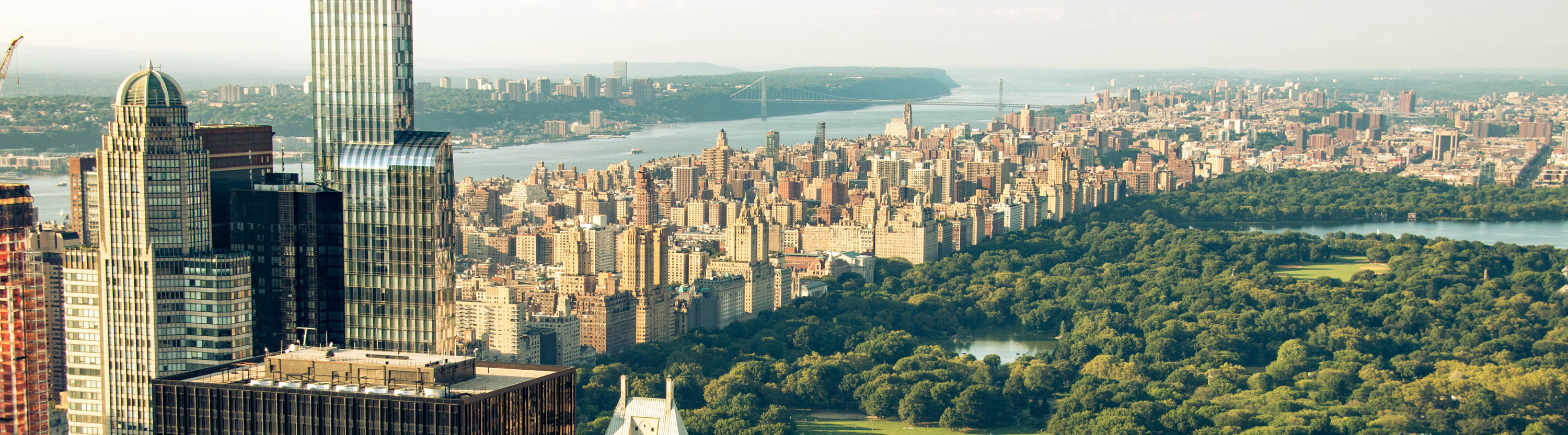 View of New York City buildings with Hudson River and Central Park