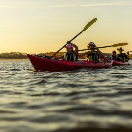 A family kayaks together on the water in Jacksonville, FL