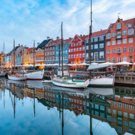 Daytime view of boats along Nyhavn Harbor in Copenhagen, Denmark