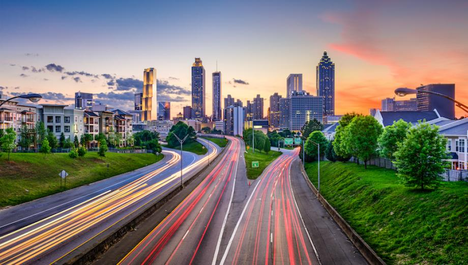view of Atlanta, GA skyline at sunset with highways buzzing