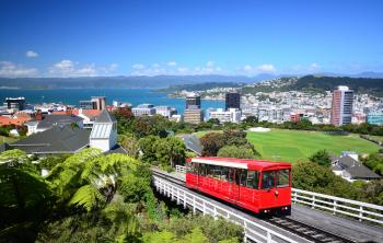 Red trolly going up a hill in Wellington, New Zealand