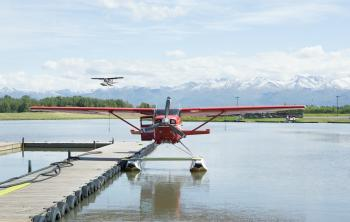 Water planes sit in the harbor of Anchorage, Alaska