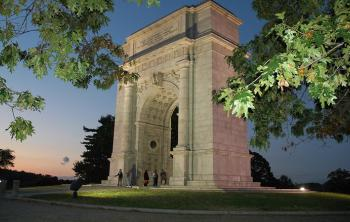 A night view of the National Memorial Arch at Valley Forge Park