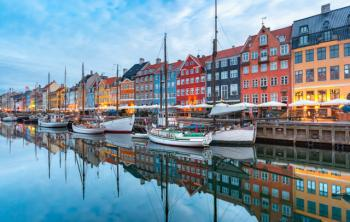 Daytime view of boats along Nyhavn Harbor in Copenhagen, Denmark