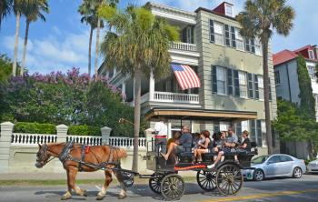 People on a carriage ride in Charleston, SC